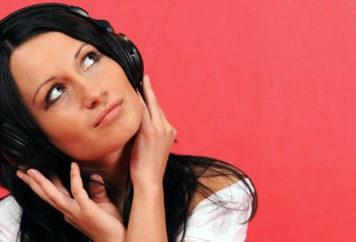 woman enjoying music with headphones