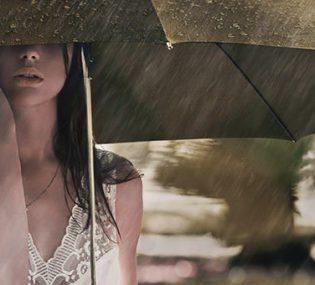 woman in the rain under her umbrella